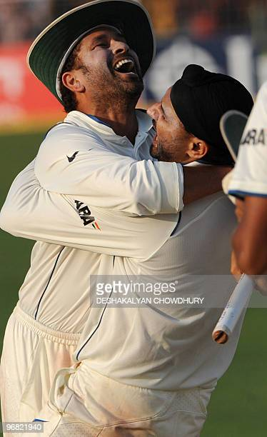 Indian cricketers Harbhajan Singh and Sachin Tendulkar celebrates as India beats the South Africans and level the series during the final day of the...