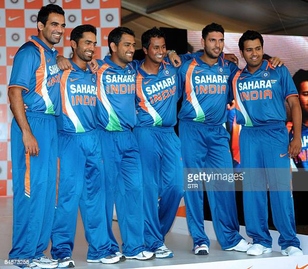 Indian cricketers led by team captain Mahendra Singh Dhoni pose during the launch of a new team kit in Mumbai on February 18 ahead of a tour of New...