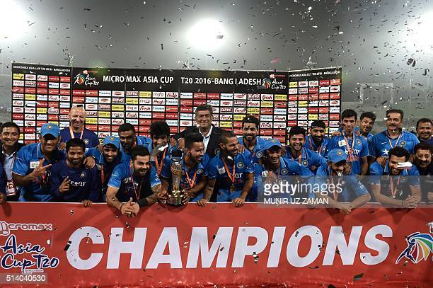 Indian cricketers pose for a photo after winning the match during the Asia Cup T20 cricket tournament final match between Bangladesh and India at the...