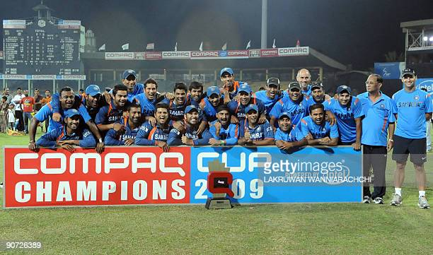Indian cricketers pose for photographers their after victory in the TriNation Championship trophy final One Day International match between India and...