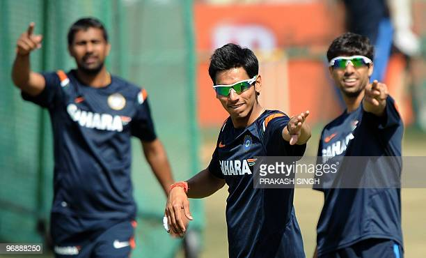 Indian cricketers Praveen Kumar Sudeep Tyagi and Ashish Nehra gesture during a training session at The Swai Mansingh Cricket Stadium in Jaipur on...