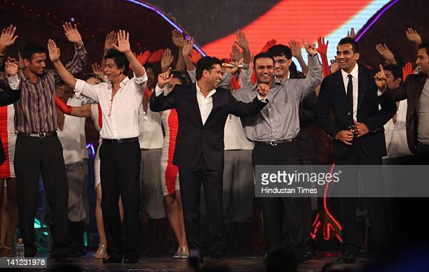 Indian cricketers Rahul Dravid Sachin Tendulkar Virender Sehwag Sourav Ganguly and Zaheer Khan dance with Indian Bollywood actor Shahrukh Khan at...