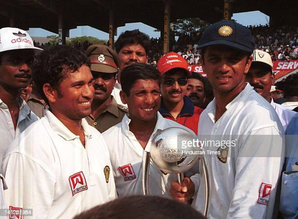 Indian cricketers Sachin Tendulkar and SS Das with Rahul Dravid winner trophy on the final day of third test match at MA Chidambaram stadium on March...