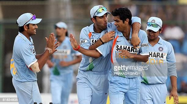 Indian cricketers Yuvraj Singh Suresh Raina and Rohit Sharma congratulate teammate Rudra Pratap Singh after he took the wicket of unseen Sri Lankan...