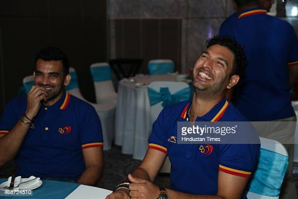 Indian cricketers Zaheer Khan and Yuvraj Singh during party thrown for Delhi Daredevils team players on April 3 2015 in New Delhi India