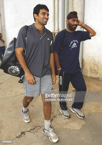Indian cricketers Zarir Khan and Sarandeep Singh arrive at the National Cricket Academy to join the national team's conditioning camp in Bangalore14...