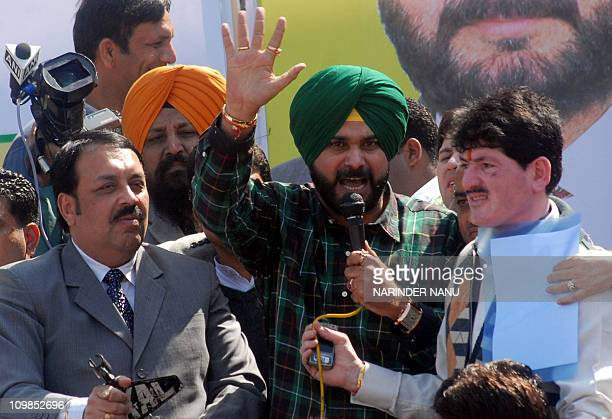 Indian cricketer-turned-politician and Bharatiya Janata Party Member of Parliament Navjot Singh Sidhu gestures as he addresses BJP activists durign a...