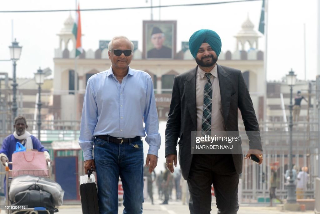 Indian cricketerturnedpolitician and Punjab cabinet minister Navjot Singh Sidhu and Vikram Singh Mehta a friend of Pakistani Prime Minister Imran...