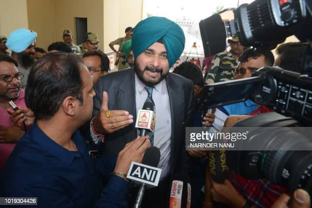 Indian cricketerturnedpolitician and Punjab cabinet minister Navjot Singh Sidhu talks to the media after crossing the IndiaPakistan border in Wagah...