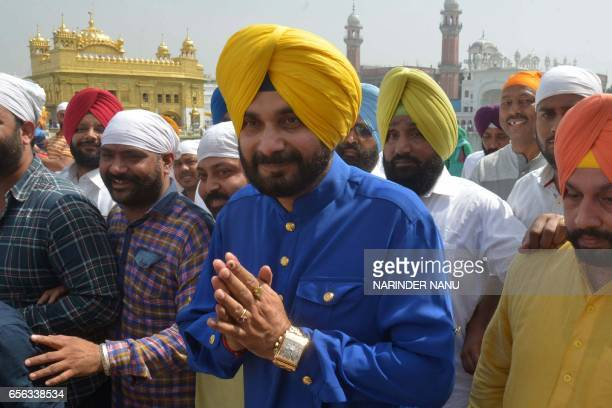 Indian cricketer-turned-politician and Punjab Cabinet Minister Navjot Singh Sidhu gestures as he pays his respects at The Golden Temple in Amritsar...