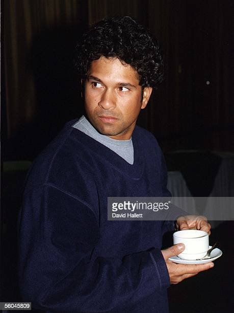 Indian cricket's batting star Sachin Tendulkar enjoys a cup of tea at the Centra Airport Hotel after the Indian Cricket team arrived in Auckland to...