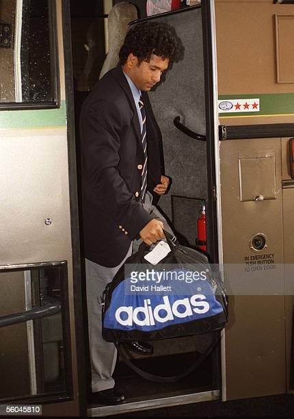 Indian cricket's batting star Sachin Tendulkar gets off the bus after the Indian Cricket team arrived in Auckland to kicj off their tour