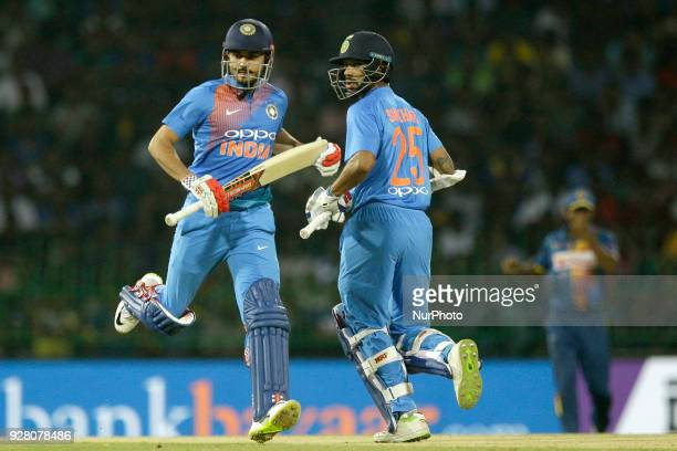 Indian crickters Manish Pandey and Shikhar Dhawan run between wickets during the 1st T20 cricket match of NIDAHAS Trophy between Sri Lanka and India...