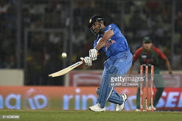 Indian crikcet captain Mahendra Singh Dhoni plays a shot during the Asia Cup T20 cricket tournament final match between Bangladesh and India at the...