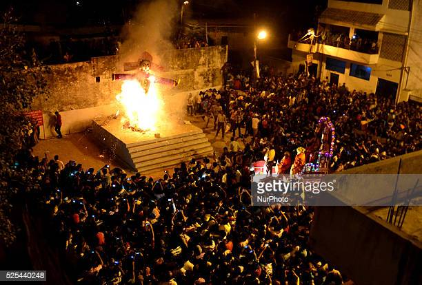 Indian Crowd gather at hanuman park to see blazing effigies of mythical character of Demon King Ravan on the ocassion of the Vijya Dashmi festival in...