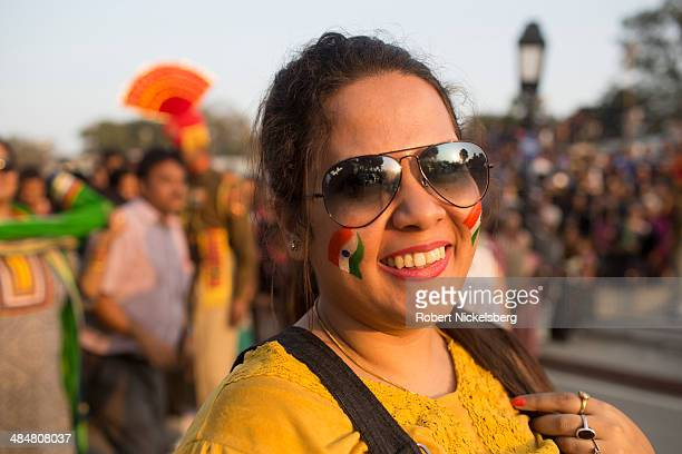 Indian crowds cheer during a daily flag lowering or Retreat ceremony at the IndiaPakistan border crossing zone February 20 2014 in Wagah India...