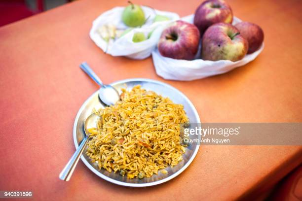 Indian cuisine: plate of pilau fried rice on table