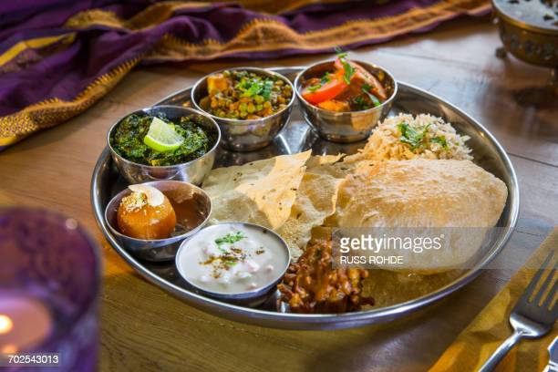 indian cuisine, thali bowls on restaurant table - indian food stock photos and pictures