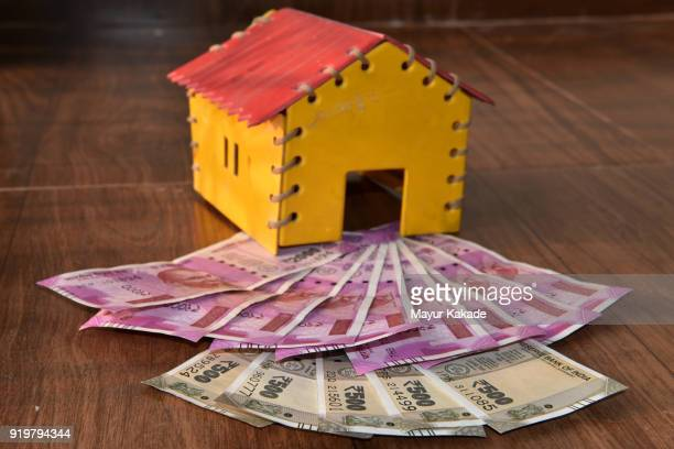 Indian currency notes with house