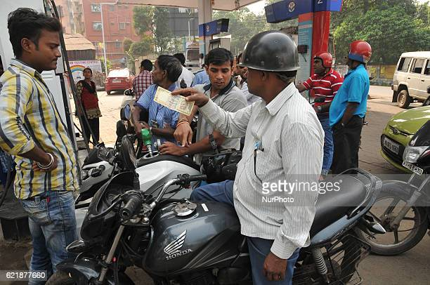Indian Customer Showing RS 500 HP PETROL PUMP dealers not to accept Rs 500 and 1000 Indian currency A closeup view of a 1000 Rupee note after India's...