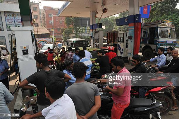 Indian Customer waiting long line HP PETROL PUMP dealers not to accept Rs 500 and 1000 Indian currency A closeup view of a 1000 Rupee note after...