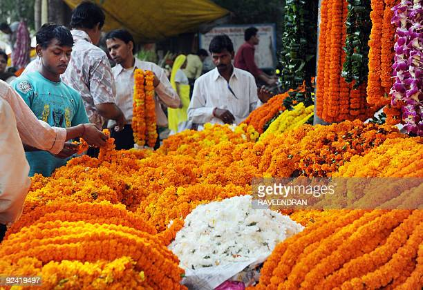 Indian customers buy marigolds used in acts of worship and to decorate homes on Diwali in New Delhi on October 17 2009 The Hindu festival of light...