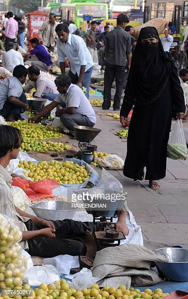 Indian customers buy vegetables at a market in New Delhi on September 28, 2011. Indian inflation rose closer to double-digits in August, official...
