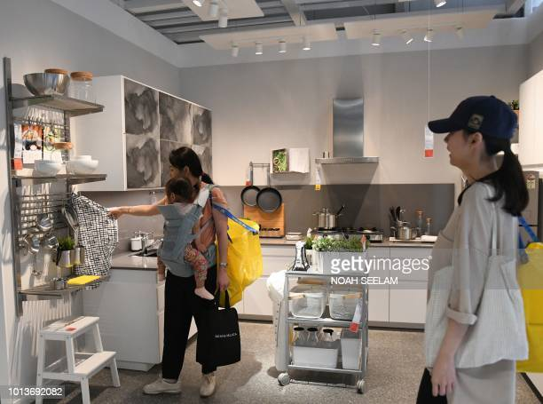 Indian customers check furnitures at the new IKEA store in Hyderabad on August 9 2018 Curious customers lay on beds and nestled into armchairs on...