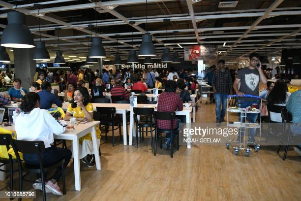 Indian customers eats at a restaurant at the new IKEA store in Hyderabad on August 9 2018 Curious customers lay on beds and nestled into armchairs on...