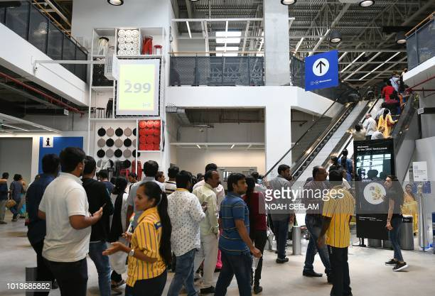 Indian customers enter at the new IKEA store in Hyderabad on August 9 2018 Curious customers lay on beds and nestled into armchairs on August 9 as...
