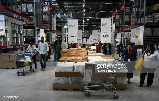 Indian customers purchase items at the new IKEA store in Hyderabad on August 9 2018 Curious customers lay on beds and nestled into armchairs on...