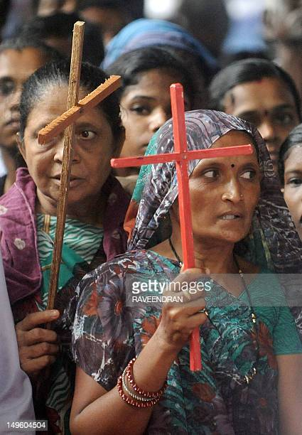 Indian Dalit untouchable Christians hold crosses during a protest rally against the National Commission for Scheduled Castes and Scheduled Tribes for...
