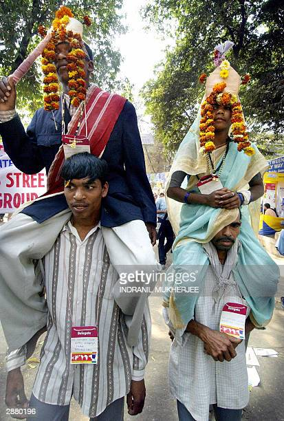 Indian Dalits, members of Hinduism lowest caste, enact a traditional Dalit wedding during a march at the 2004 World Social Forum , in Bombay, 19...