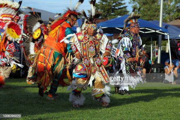 indian dancers at plains indian museum pow-wow - rainer grosskopf stock pictures, royalty-free photos & images