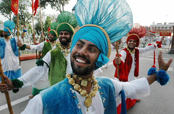 Indian dancers perform a traditional Punjabi `Bhangra` dance at the Wagah Border Post15 August 2005 as the country celebrates Independence Day Indian.