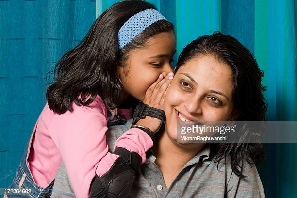Indian Daughter sharing a secret with her Mother People Horizontal