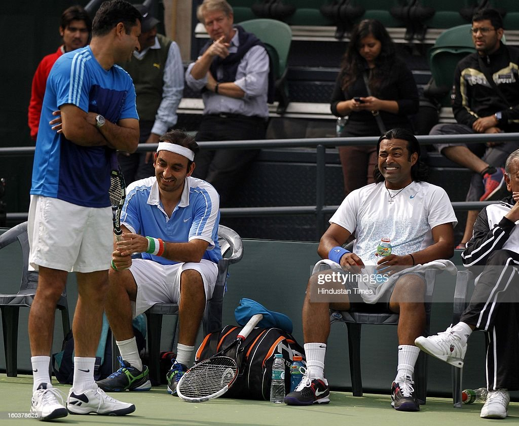 Indian Davis Cup player Leander Paes shares a light moment with Coach Zeeshan Ali during the practice session at DLTA on January 30, 2013 in New Delhi, India. After the rebellion by top Indian tennis players AITA has fielded an inexperienced team for the Davis Cup tie against South Korea that will begin on February 1.