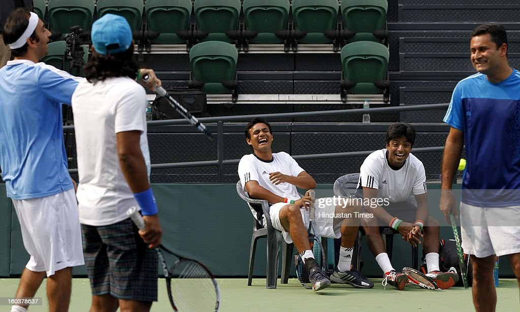 Indian Davis Cup player Vijayant Malik and Ranjeeth shares some light moments with Leander Paes during the practice session at DLTA on January 30, 2013 in New Delhi, India. After the rebellion by top Indian tennis players AITA has fielded an inexperienced team for the Davis Cup tie against South Korea that will begin on February 1.
