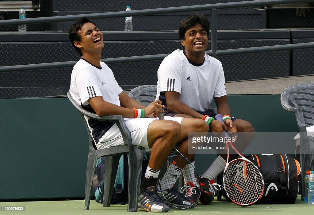 Indian Davis Cup player Vijayant Malik (L), Ranjeeth (R) and Leander Paes shares some light moments during the practice session at DLTA on January 30, 2013 in New Delhi, India. After the rebellion by top Indian tennis players AITA has fielded an inexperienced team for the Davis Cup tie against South Korea that will begin on February 1.