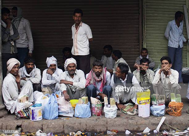 Indian day labourers wait for work on the side of a road in the Old Quarters of New Delhi on November 3 2012 India's economic growth has slowed to a...