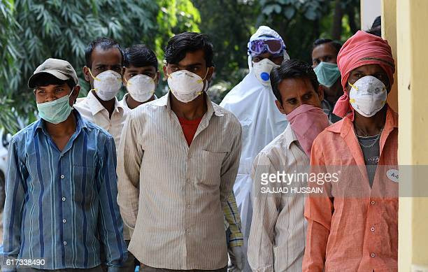 Indian Deer Park workers queue for medicine to be taken as a precautionary measure inside the Deer Park which is temporarily closed for visitors as a...
