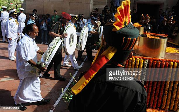 Indian Defence Minister A K Anthony lays a wreath along with Indian Air Force Chief Pradeep Vasant Naik Indian Navy Chief Admiral Nirmal Verma and...