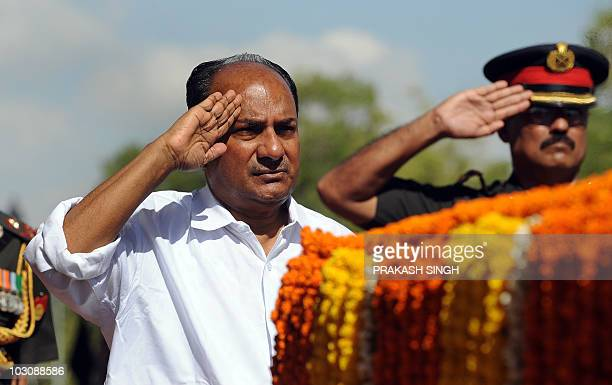 Indian Defence Minister A K Anthony salutes during a tribute ceremony to commemorate eleven years since the victory of the Kargil war in New Delhi on...