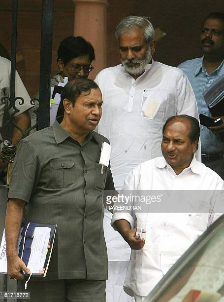 Indian Defence Minister AK Antony talks with Shipping Minister TR Balu as they leave the Prime Minister's office after a Cabinet Minister's meeting...