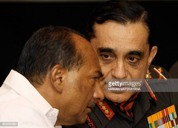 Indian Defence Minister AKAntony listens to the Indian Chief of Army Staff General Deepak Kapoor during an International Technoloy Seminar in New...