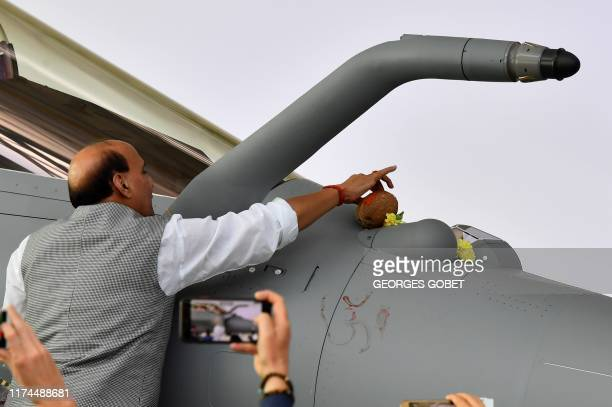 Indian Defence minister Rajnath Singh inaugurates the first of 36 Rafale fighter jets destined for India during the delivery ceremony on October 8...