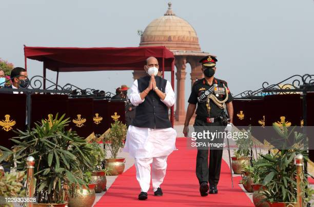 Indian Defence Minister, Rajnath Singh , wearing a face mask arrives to receive the U.S. Defence Secretary Mark Esper during a ceremonial reception...
