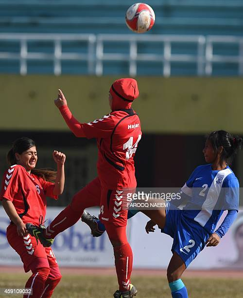 Indian defender Gurumayum Radharani is challenged by Afghanistan player Hajjar during their match in the 3rd South Asian Football Federation women's...