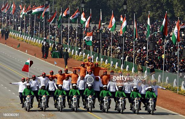 Indian defense force personnel perform stunts on motorcycles during the 64th Republic Day parade celebration at Raj path on January 26 2013 in New...
