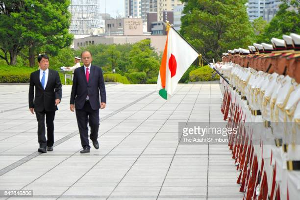 Indian Defense Minister Arun Jaitley reviews the honour guard with Japanese Defense Minister Itsunori Onodera during the welcome ceremony at the...